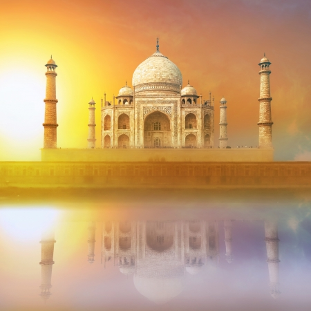 Taj Mahal India Sunset. Agra, Uttar Pradesh. Beautiful Palace with reflection in river. Wonderful landscape. Stock Photo