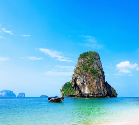 Thailand beach  Beautiful tropical landscape with boat, blue and clear ocean water, white sand and island  Thai journey photography