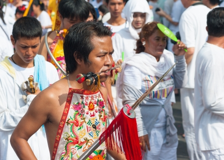 PHUKET, THAILAND- OCT 23: Unidentified participant the parade on October 23, 2012 Vegetarian Festival Phuket Thailand. The Festival is a famous annual festival also known as Nine Emperor Gods festival Stock Photo - 20390392