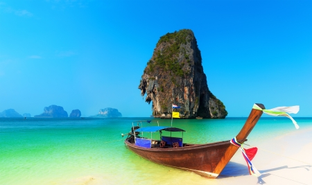 Thailand beach landscape tropical background. Asia ocean nature and wooden boat photo