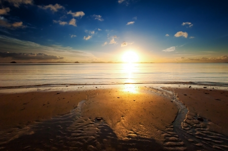 Sunrise sea beach sky landscape Beautiful sun light\ reflection in ocean water nature background
