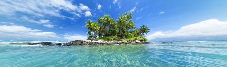 header image: Panoramic image of tropical island. Web site or blog photo header or banner design for travel, tourism, sea or tropical nature theme. Stock Photo