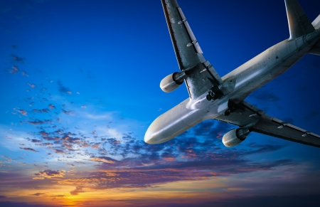 Airplane journey and sunset sky  Air traveling background, air jet with passengers flying to vacation trip