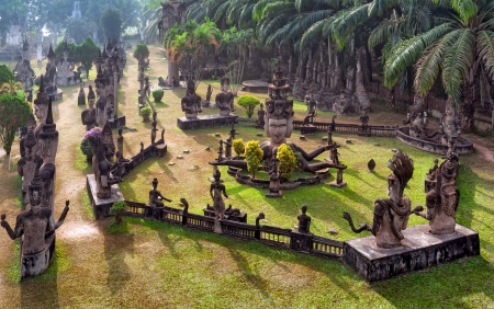 vientiane: Buddha park in Vientiane, Laos  Famous travel tourist landmark of Buddhist stone statues and religious figures