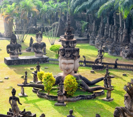 Buddha park in Vientiane, Laos  Famous travel tourist landmark of Buddhist stone statues and religious figures