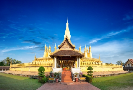 vientiane: Laos travel landmark, golden pagoda wat Phra That Luang in Vientiane  Buddhist temple  Famous tourist destination in Asia Stock Photo