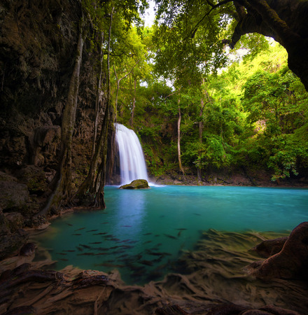 Waterfall in tropical forest  Beautiful nature background  Jungle trees and blue water of mountain river in national park in Thailand, Asia photo