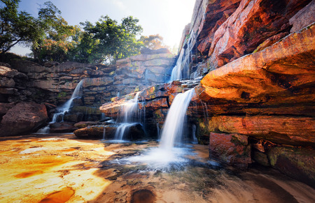 Waterfall and mountain landscape  Fresh water river stream flowing through beautiful rocky canyon  Nature photography Standard-Bild