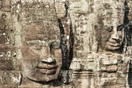 murals: Angkor Wat Cambodia  Bayon temple in Angkor Thom historical place  Human face and figures murals and carvings Stock Photo
