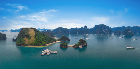 ha: Panorama of Halong Bay Vietnam  Panoramic view of Ha Long islands, tourist junks, rock mountains and tropical sea water of famous landmark in Asia