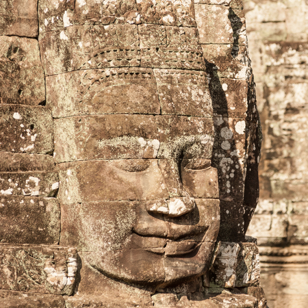 angkor thom: Angkor Wat Cambodia. Bayon temple in Angkor Thom historical place. Human face and figures murals and carvings