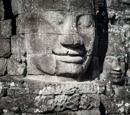 murals: Angkor Wat Cambodia. Bayon temple in Angkor Thom historical place. Human face and figures murals and carvings