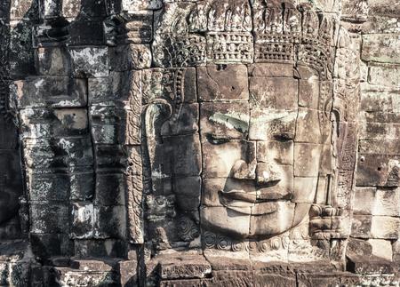 bayon: Angkor Wat Cambodia. Bayon temple in Angkor Thom historical place. Human face and figures murals and carvings