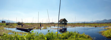 inle: Inle Lake Myanmar, Shan state  Floating gardens of rural Intha village farms on water  Eco nature panorama Stock Photo