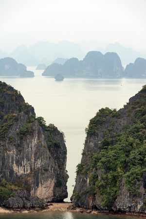 Halong Bay Vietnam natural landscape background. Famous tourist travel destination landmark in Asia. Islands, mountains and rock cliffs in tropical sea water. Beautiful nature photography. Stock Photo - 29488365