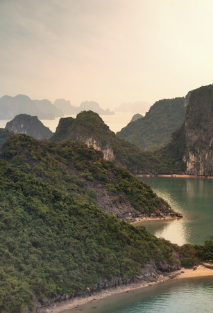 Halong Bay Vietnam natural landscape background. Famous tourist travel destination landmark in Asia. Islands, mountains and rock cliffs in tropical sea water. Beautiful nature photography. photo