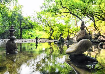 Zen meditation landscape. Calm and spiritual nature environment. Stone balance 스톡 콘텐츠