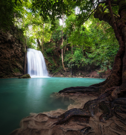 Thailand outdoor photography of waterfall in rain jungle forest  Trees, foliage and clear water of mountain river photo