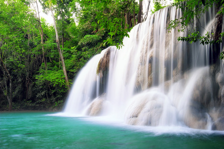 Waterfall in tropical forest of Thailand photo