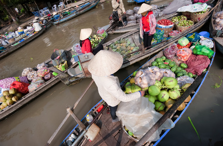 vietnamese food: CAN THO,VIETNAM - 23 JAN, 2014: Unidentified people on floating market in Mekong river delta. Cai Rang and Cai Be markets are very popular among the local citizens and tourists. Editorial