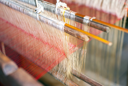 Silk production factory. Traditional manufacturing in Asia photo