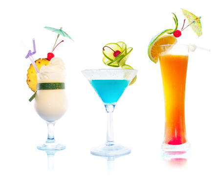 Cocktails isolated on white background. Set of tropical alcoholic drinks: Pina colada, Margarita and Tequila Sunrise photo