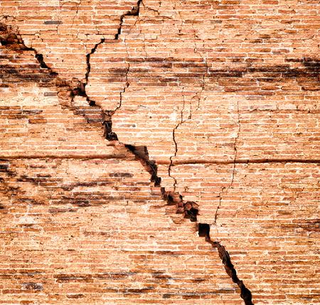 broken brick: Broken brick wall with crack Stock Photo