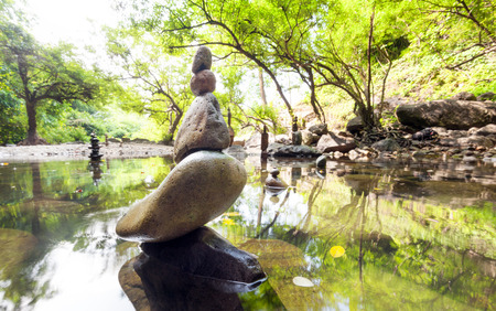 calmness: Zen garden. Meditate spiritual landscape of green forest with calm pond water and stone balance rocks