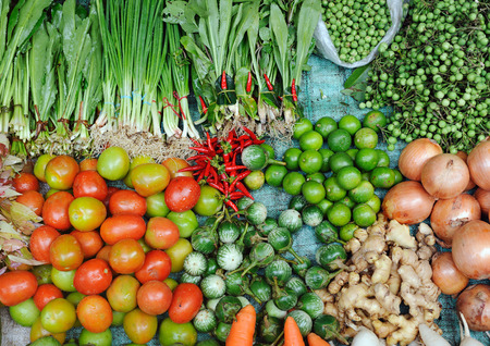 food sales: Various fresh vegetables in Asian traditional street market. Healthy food background