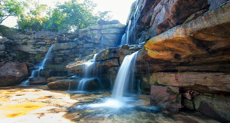 Nature landscape background of waterfall and rocks photo