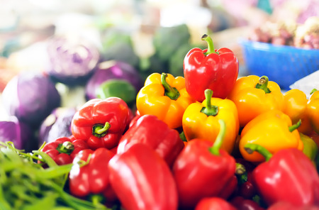 asian produce: Red and yellow organic sweet peppers on vegetables market of Thailand Stock Photo