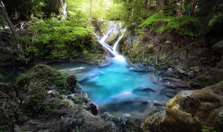 deep: Majestic nature background of mountain river stream and small blue water lake in wild tropical forest