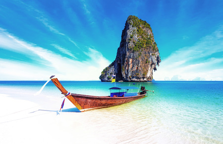 Sand beach on sea coast of tropical island in Thailand at sunny summer day with blue sky and clear water. Holiday vacation background Zdjęcie Seryjne