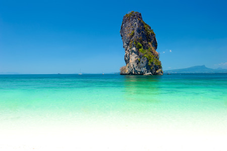Natural rock formation in turquoise water of tropical sea in Thailand near Phuket island. Seaside photography