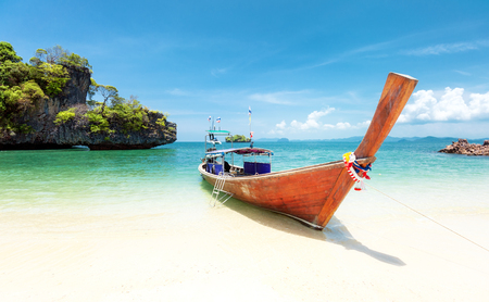 Summer day on exotic beach of tropical island. Thailand tourism landscape