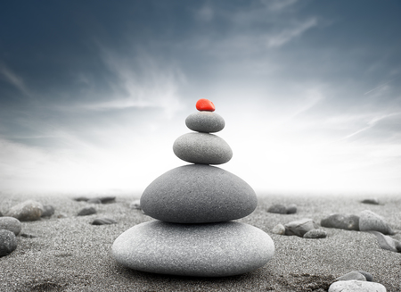 spiritual background: Dramatic spiritual background of zen-like stone pyramid. Tranquil and calm concept Stock Photo