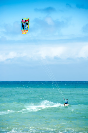 Summer extreme sports. Kite surf activity of professional athlete