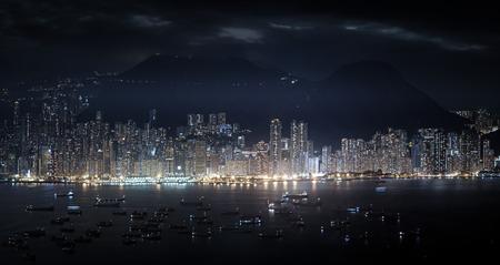 metropolis: Modern metropolis panorama at night. High skyscrapers of Hong Kong