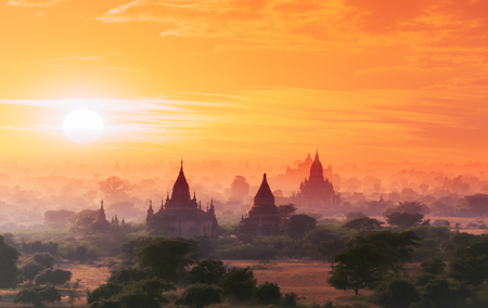 panoramic view: Myanmar Bagan historical site on magical sunset with beautiful sky and Buddhist temples panoramic view