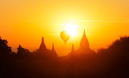 Silhouettes of ancient temples of Bagan historical site in Myanmar (Burma) at summer sunset