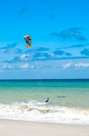 Active lifestyle sport background. Kite surfer near ocean coast beach Stok Fotoğraf