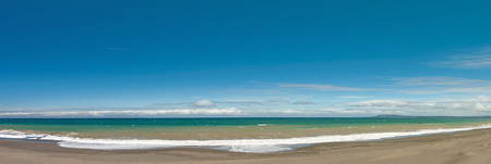 sandy beach: Long and empty ocean coast beach panoramic view background