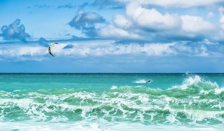 watersport: Summer watersport background of kite surfing and blue ocean water with waves and splashes Stock Photo