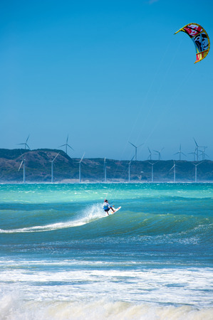 Acrobatic action with kite surf on blue sea waves