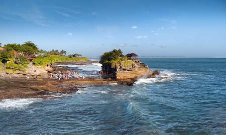 Bali island Tanah Lot Temple on sea at sunny summer day