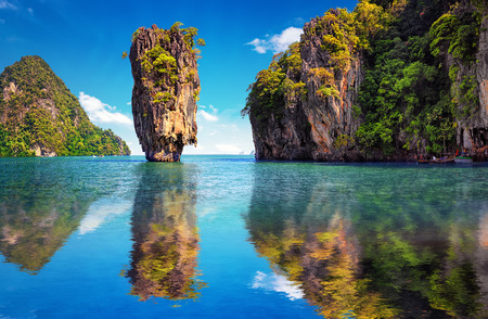 natural landmark: Beautiful nature of Thailand. James Bond island reflects in water near Phuket Stock Photo