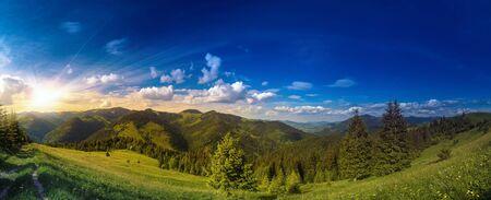 Sunset over carpathian mountains panorama.