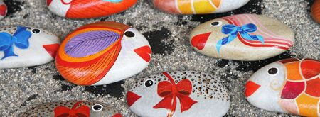 painted: souvenir stone small fishes from the island of Crete. Greece