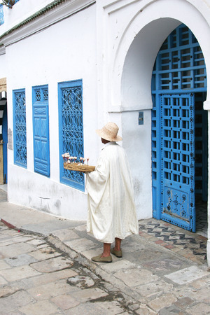sidi bou said: Seller jasmine flowers waiting for tourists. Tunisia. Sidi Bou Said