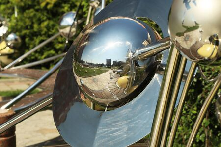 Reflections of the city in a metal bowl. Modern architecture